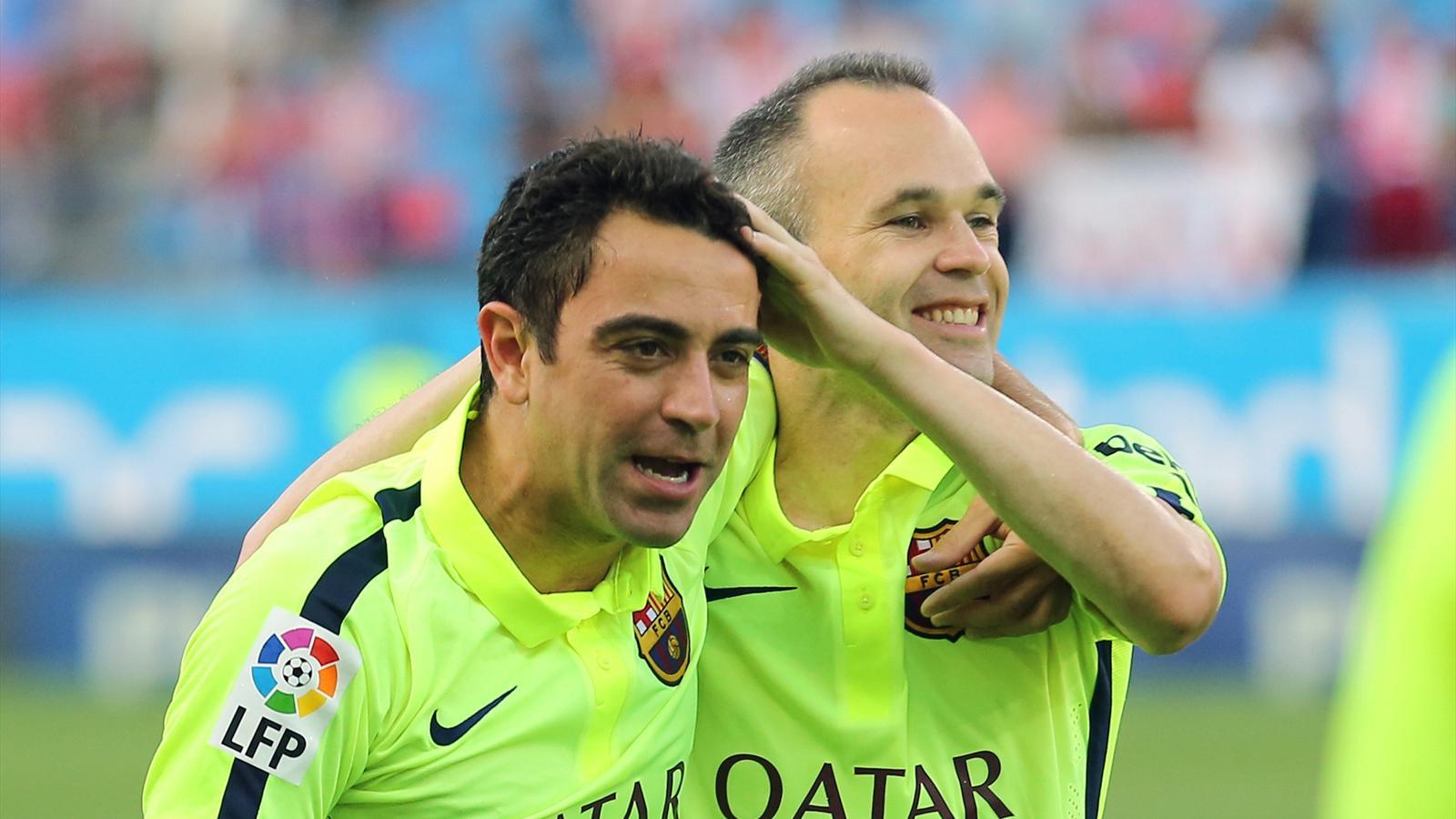 Xavi Iniesta Barcellona 2015 AFP