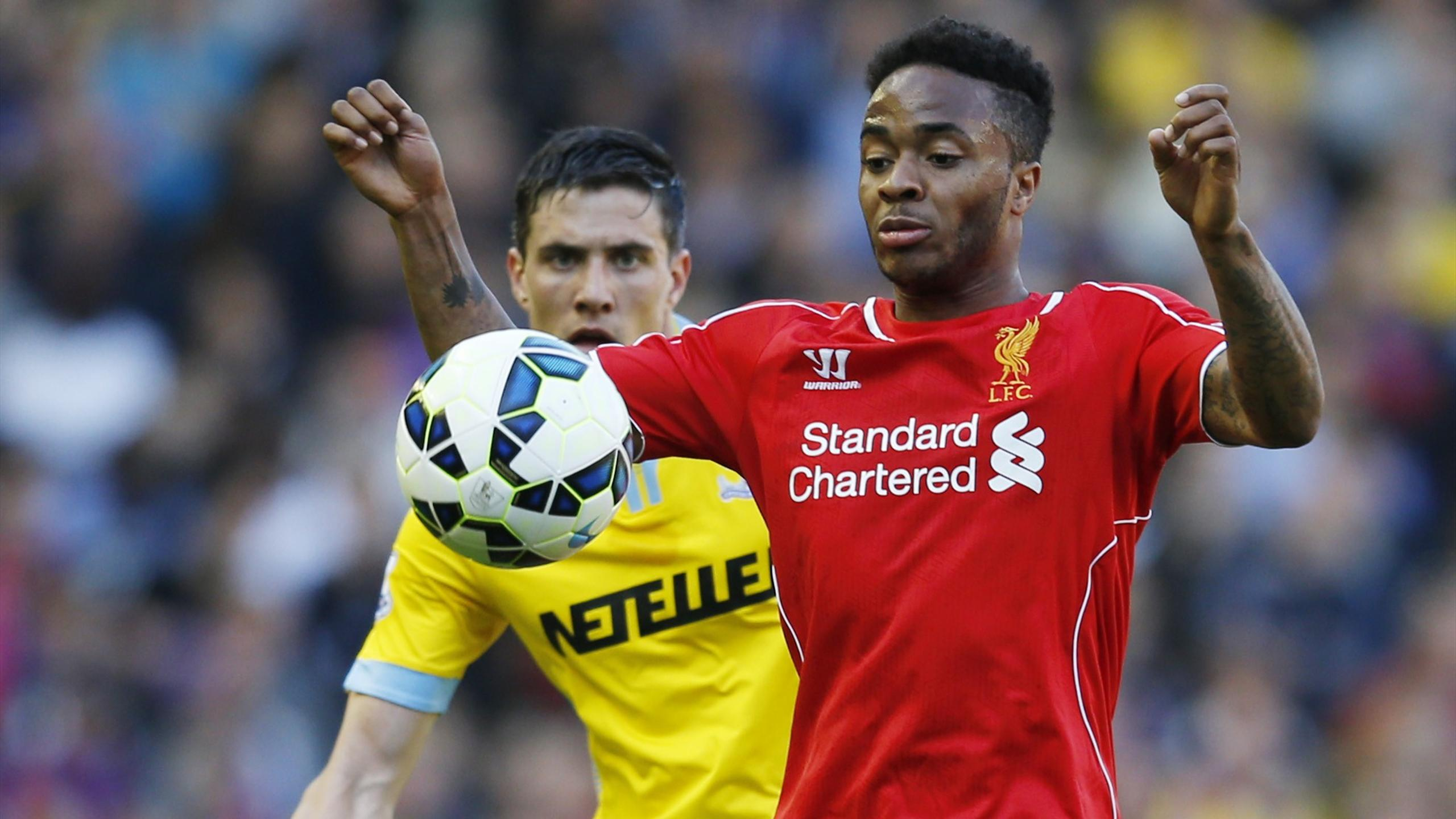 Crystal Palace's Martin Kelly in action with Liverpool's Raheem Sterling