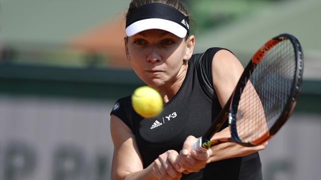Simona Halep huffs and puffs into Roland Garros second round