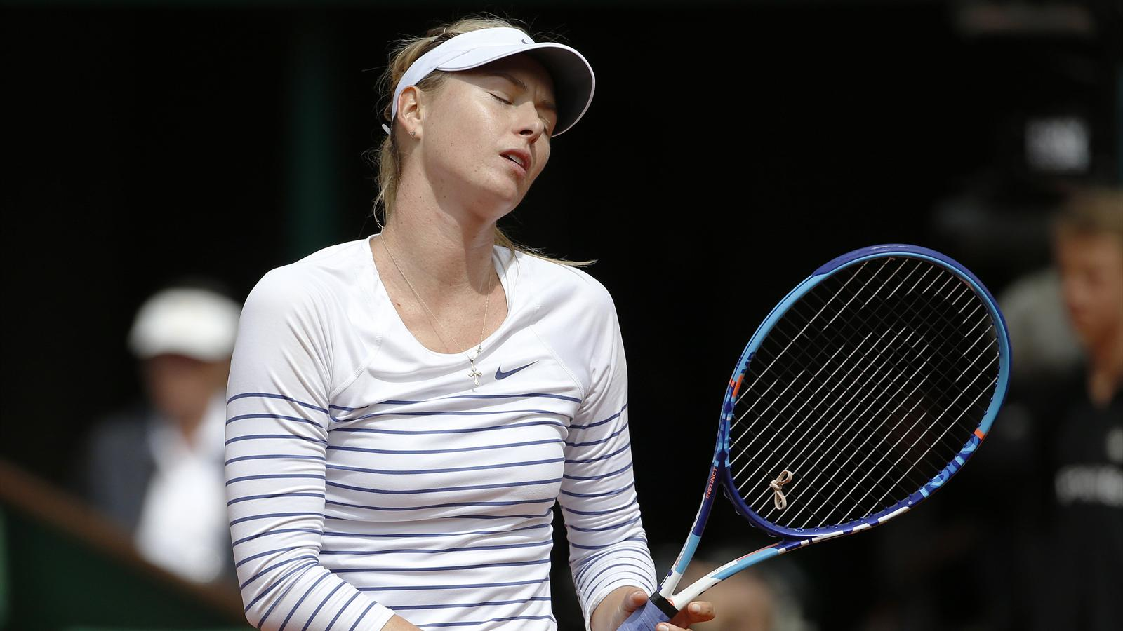 Maria Sharapova is knocked out of the French Open by Lucie Safarova