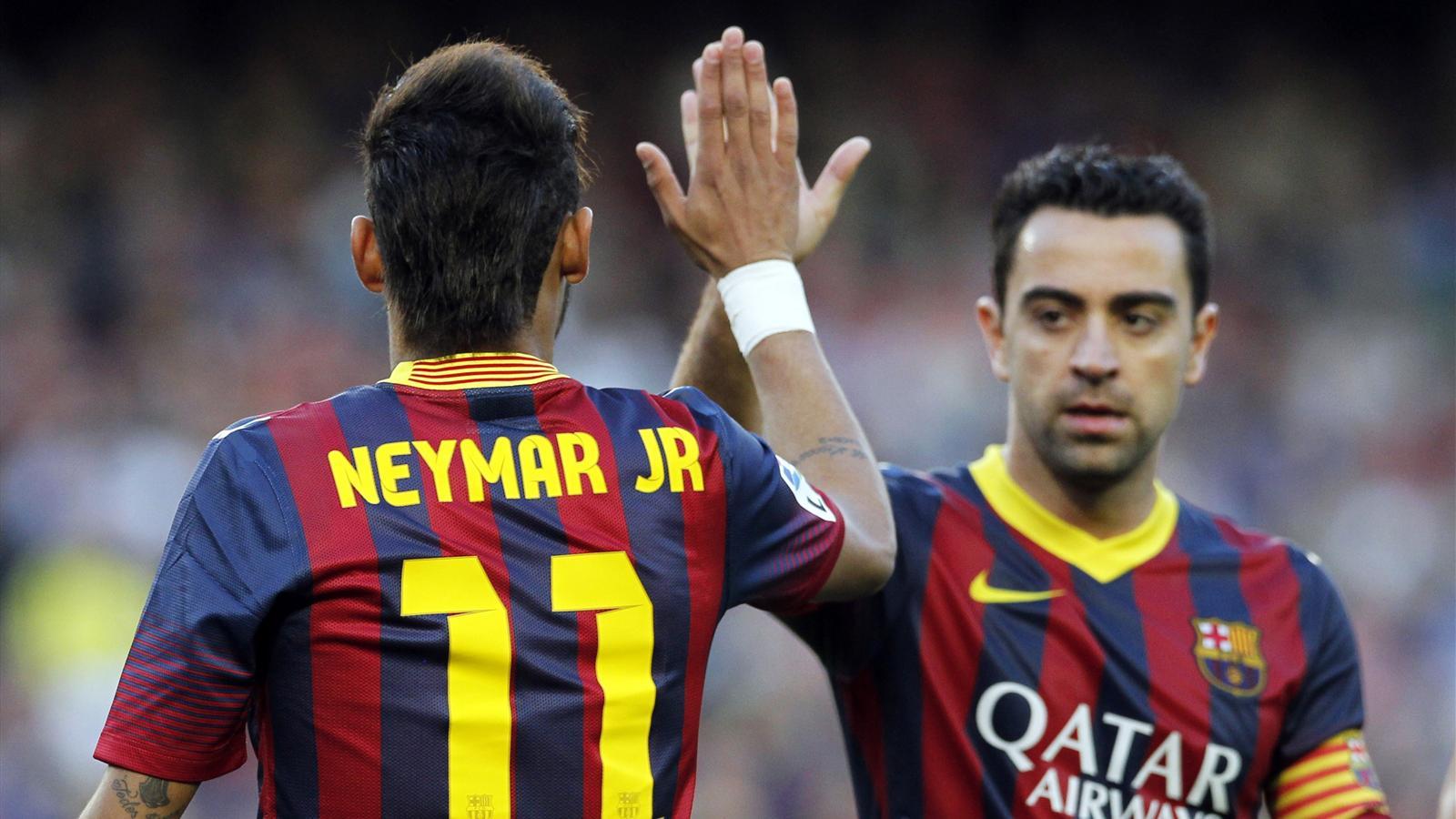 Barcelona's Neymar high-fives Xavi