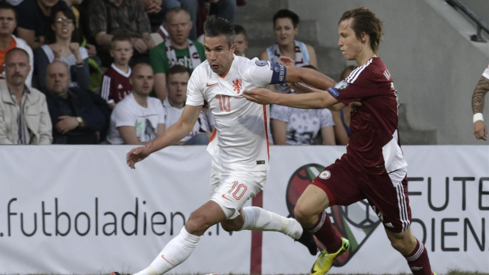 Netherlands' Van Persie fights for ball with Latvia's Ikaunieks