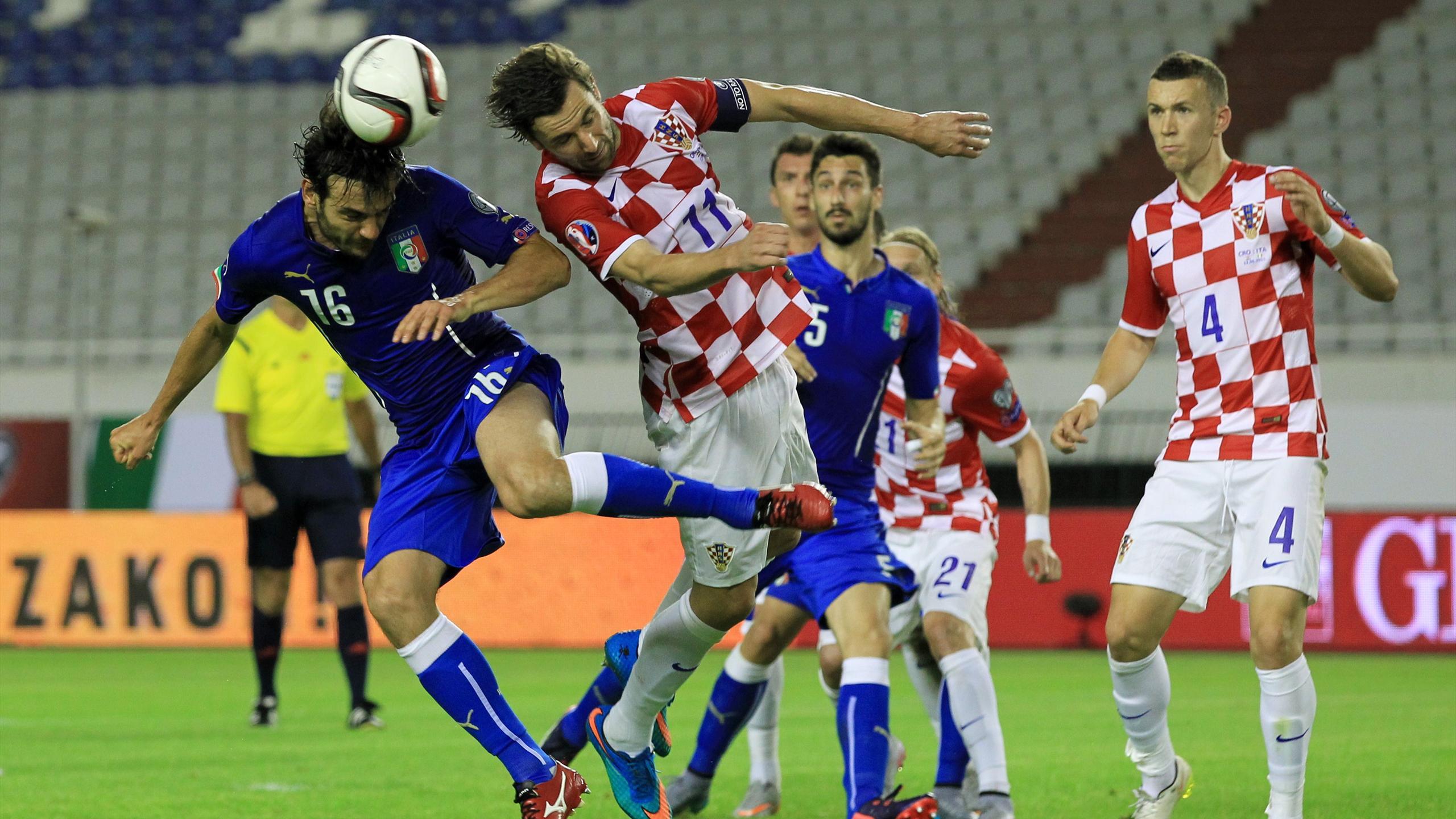 Italy's Marco Parolo (L) heads the ball past Croatia's Darijo Srna
