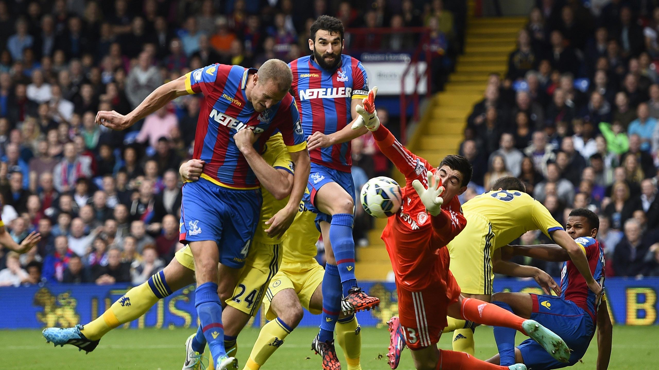 Crystal Palace's Brede Hangeland (L) has a header saved by Chelsea's Thibaut Courtois