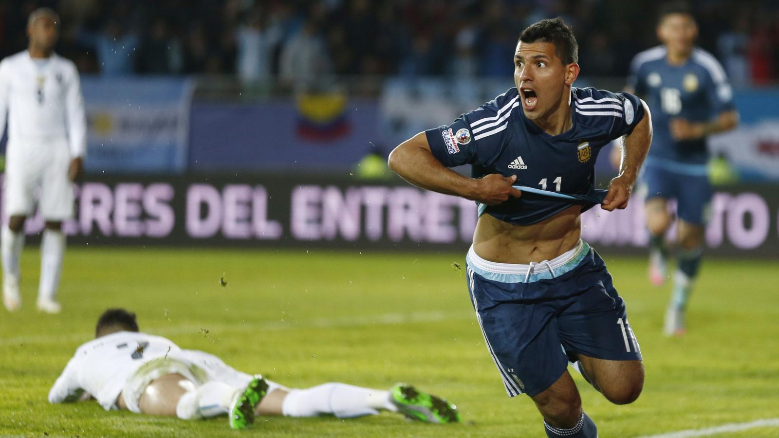 Argentina's Sergio Aguero celebrates a goal against Uruguay during their first round Copa America match at Estadio La Portada in La Serena, Chile