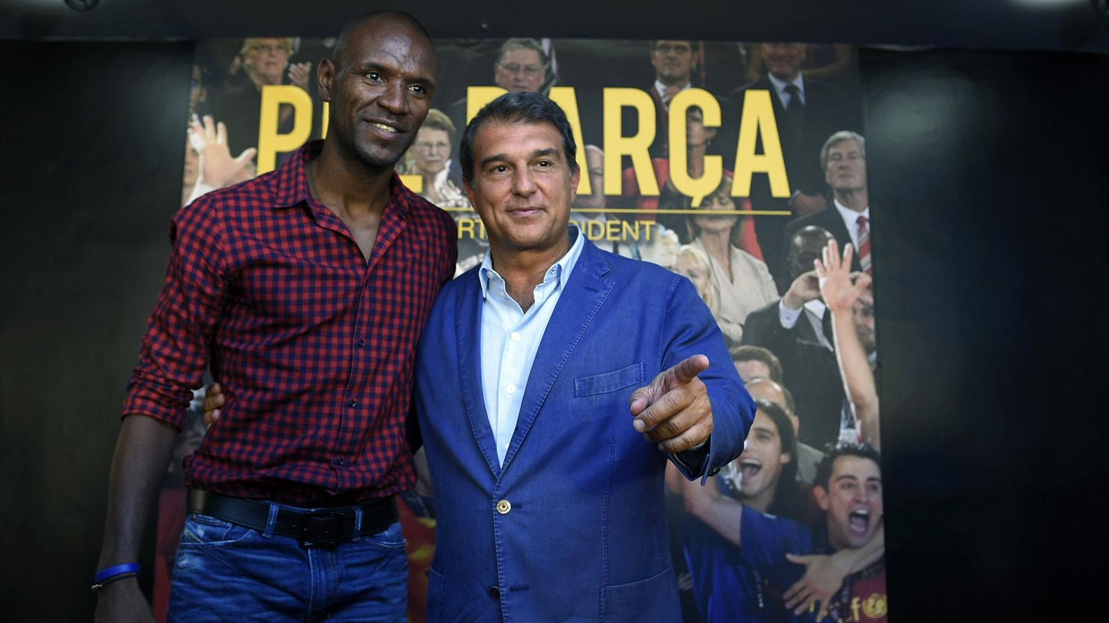 Candidate for presidency of FC Barcelona, Joan Laporta (R) poses with former FC Barcelona's player Eric Abidal during a press conference on his plans for the football team, in Barcelona on June 22, 2015