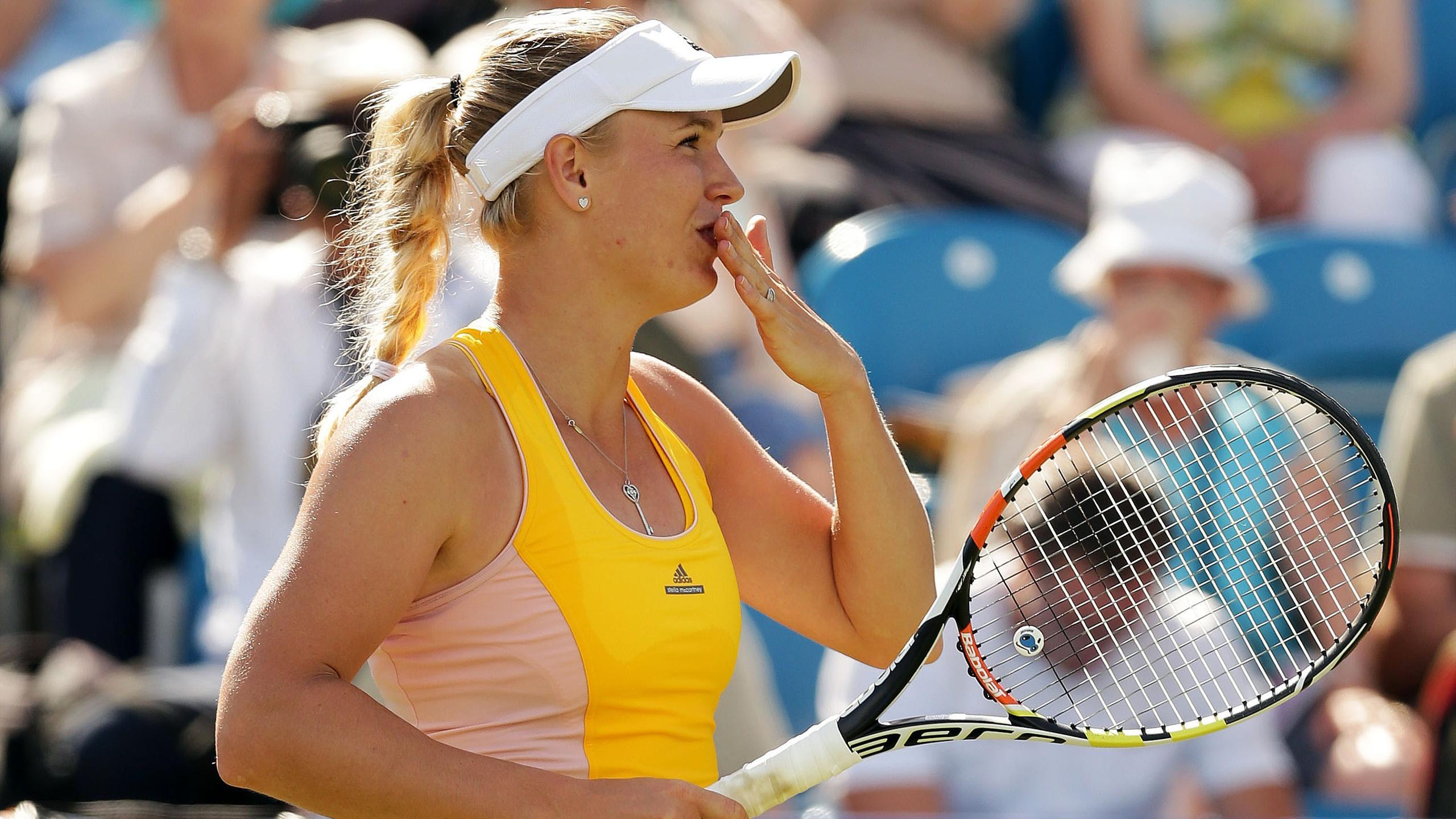 Denmark's Caroline Wozniacki celebrates winning her quarter final match
