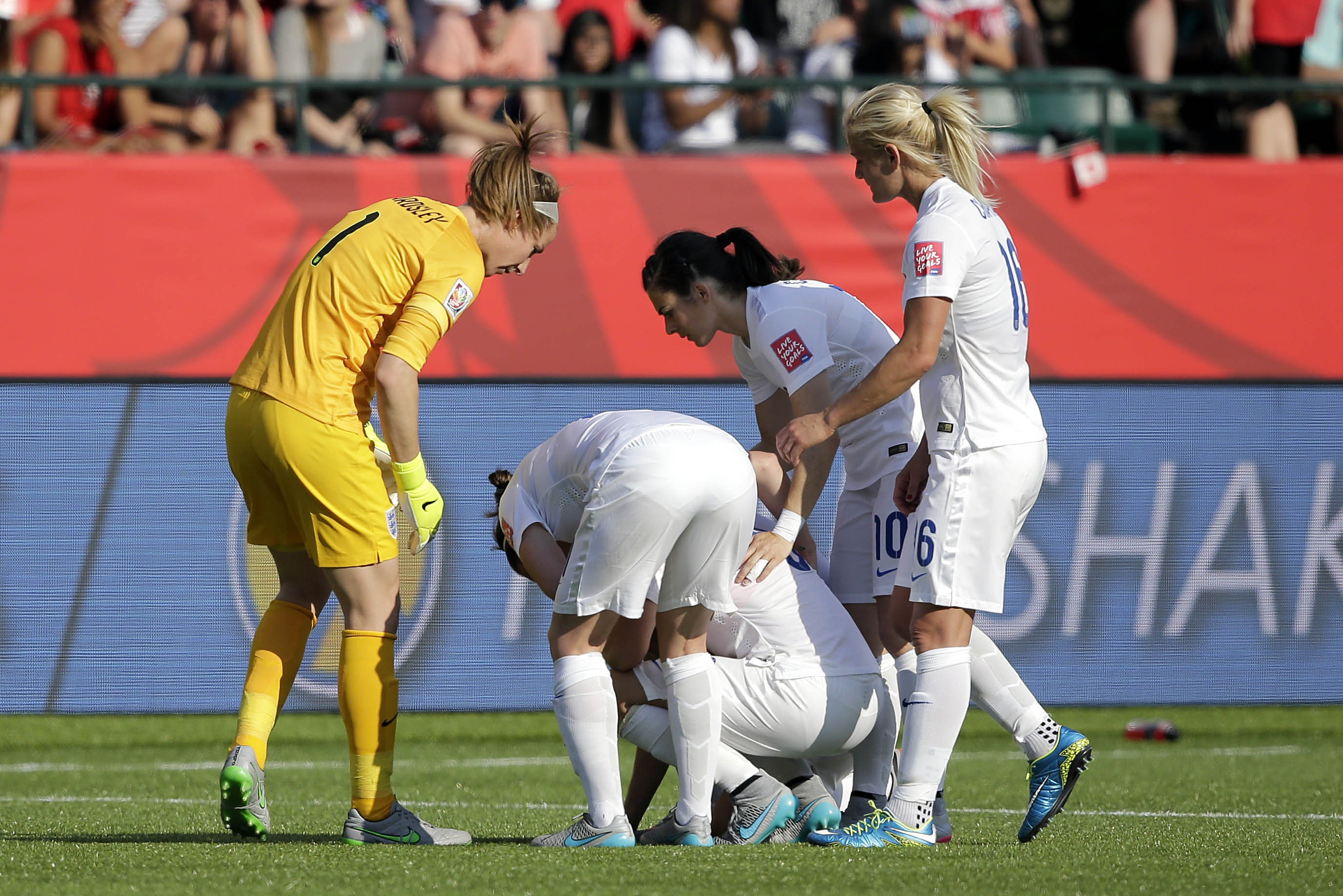 Laura Bassett is consoled by her England team-mates