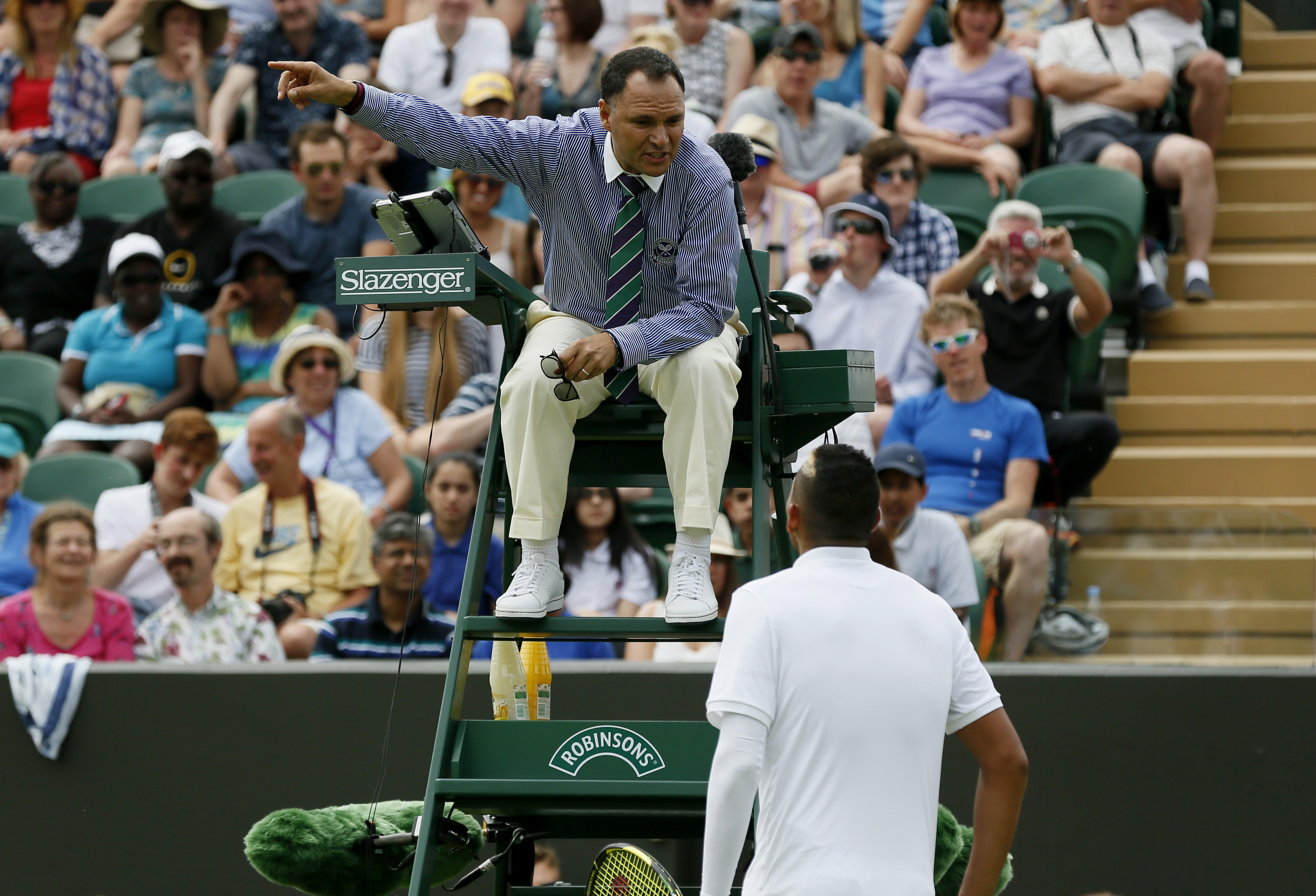 'Southfields tube station? Yeah, out the door, turn right, down the road for half a mile. You can't miss it.' - Nick Kyrgios of Australia speaks to an umpire at Wimbledon