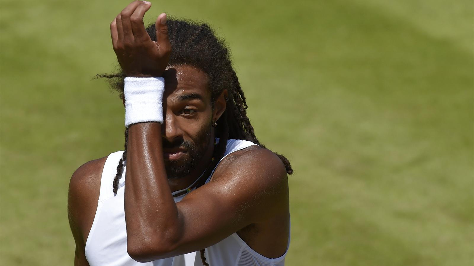 Dustin Brown of Germany wipes his face during his match against Viktor Troicki