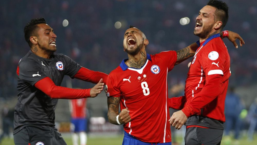 Chile's Arturo Vidal (8) celebrates with team-mates after defeating Argentina to win the Copa America