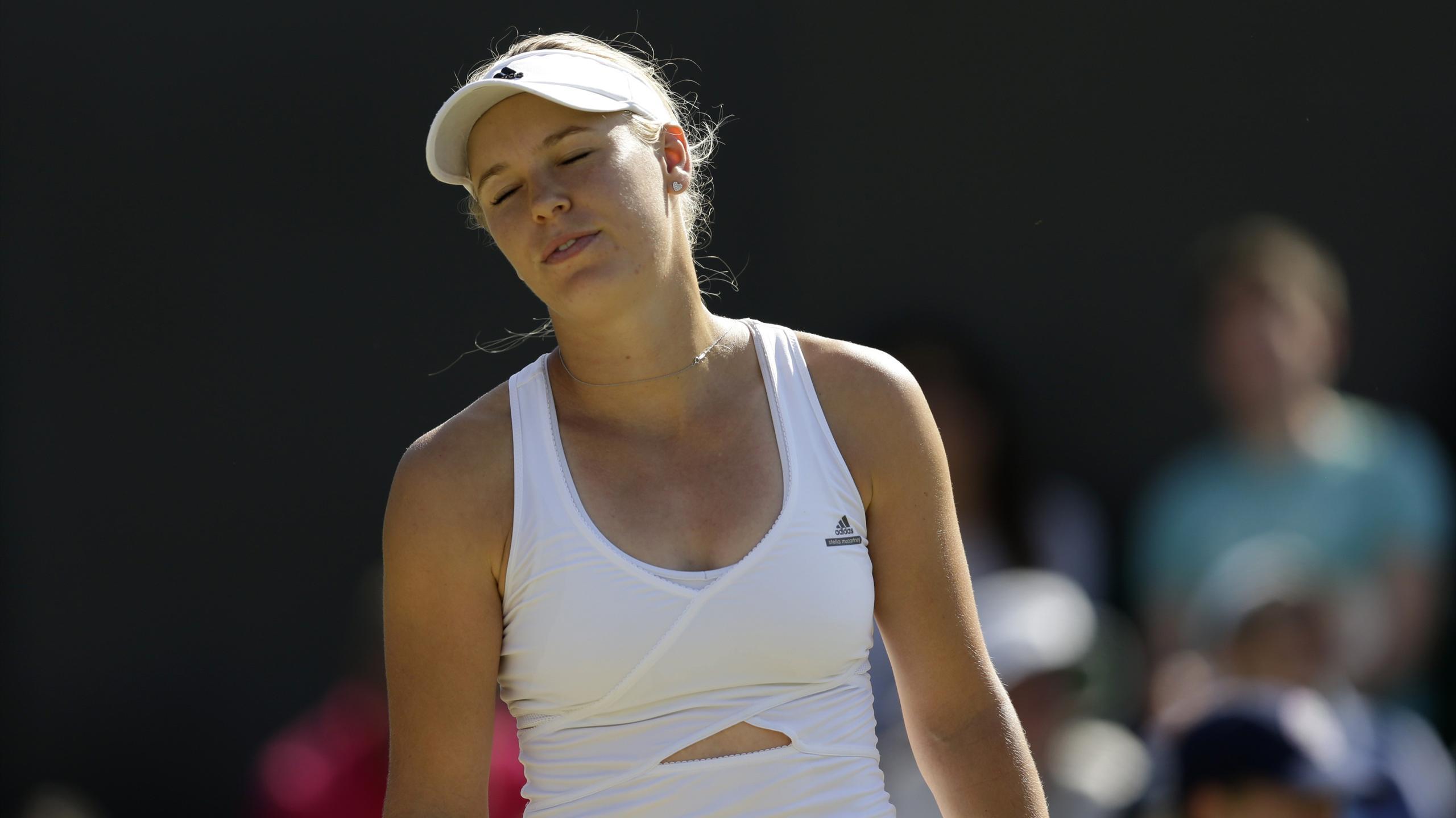 Caroline Wozniacki of Denmark reacts during her match against Garbine Muguruza of Spain at Wimbledon
