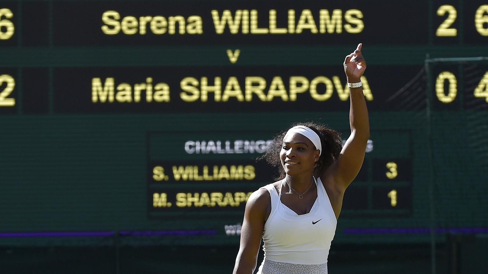 Serena Williams celebrates after winning her match against Maria Sharapova