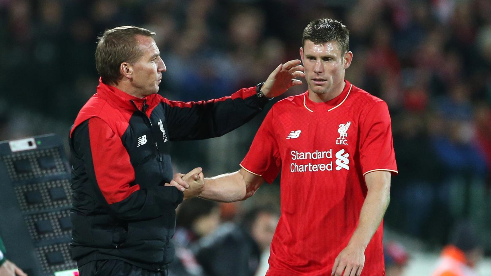 Liverpool manager Brendan Rodgers with summer signing James Milner