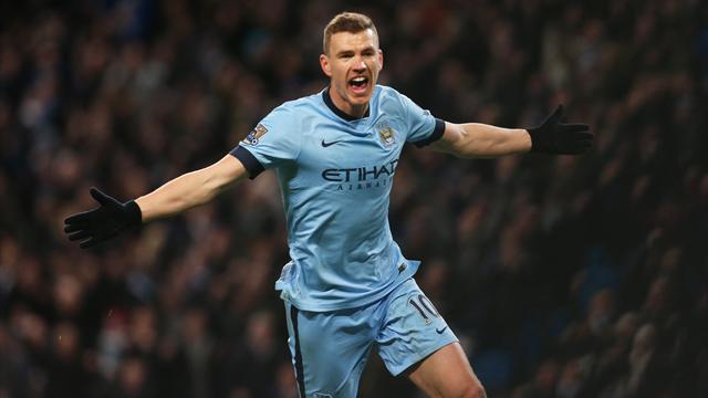 Edin Dzeko celebrates after scoring the third goal for Manchester City