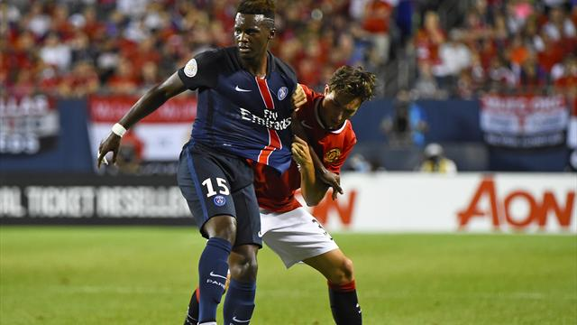 Paris Saint-Germain forward Jean-Christophe Bahebeck (15) kicks the ball against Manchester United defender Matteo Darmian (36)