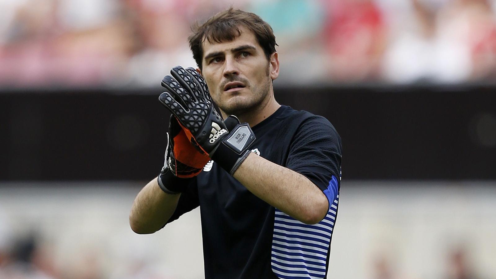 Porto goalkeeper Iker Casillas applauds the fans