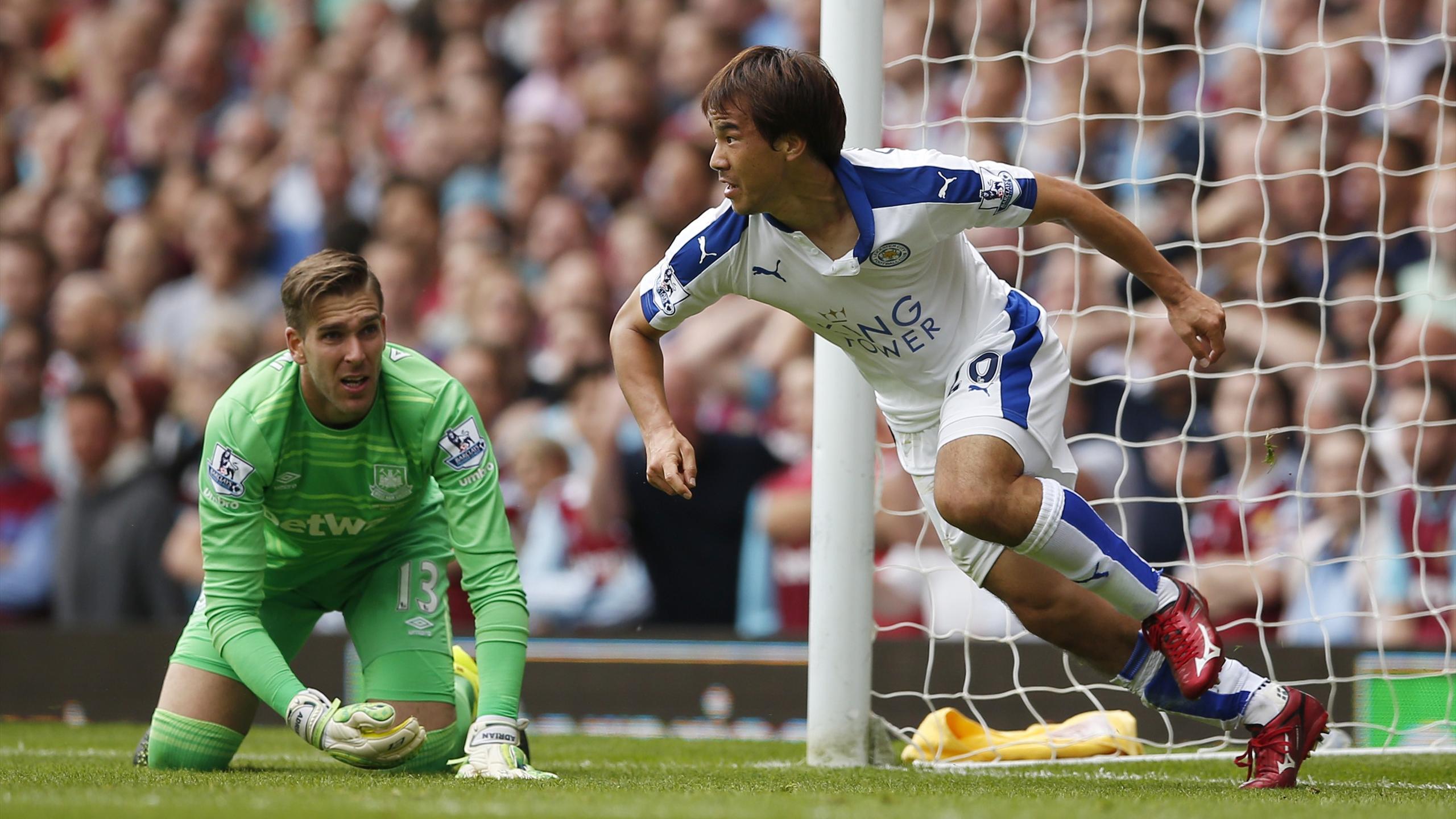 Shinji Okazaki celebrates scoring the first goal for Leicester as West Ham's Adrian looks on