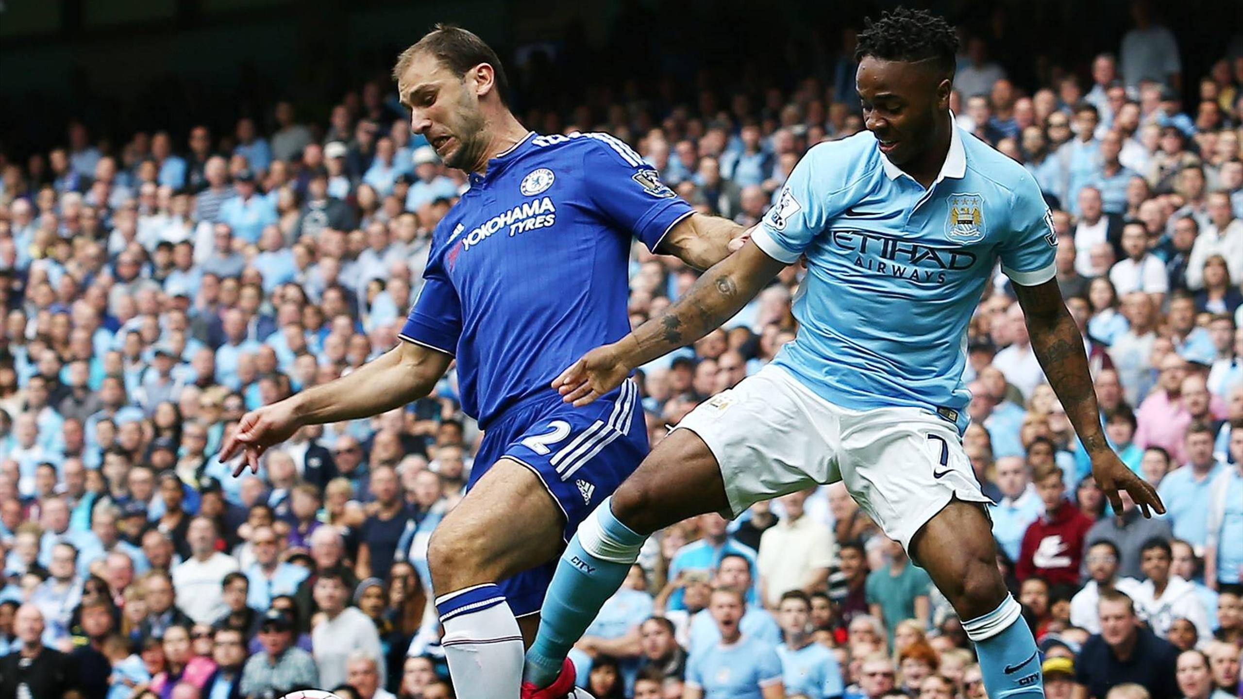 Branislav Ivanovic holds off Raheem Sterling of Manchester City