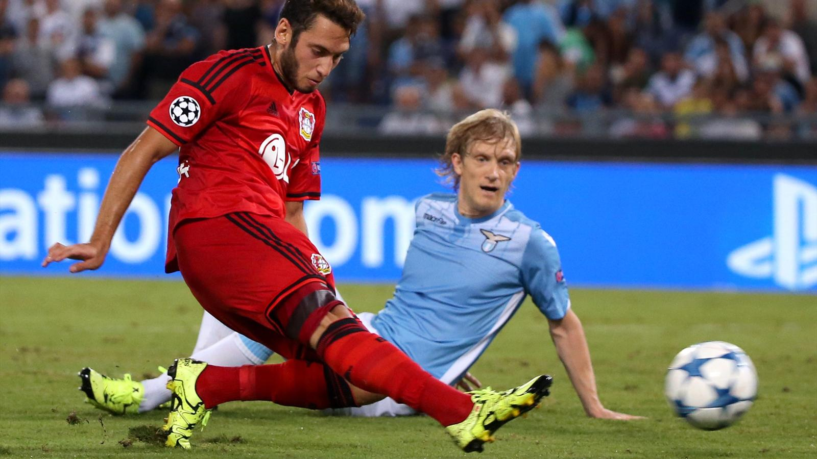 Bayer Leverkusen's Hakan Calhanoglu scores a goal which is then disallowed, as Lazio's Dusan Basta (R) watches during their Champions League play-off soccer match at the Olympic stadium in Rome, Italy August 18, 2015. REUTERS/Alessandra Bianchi