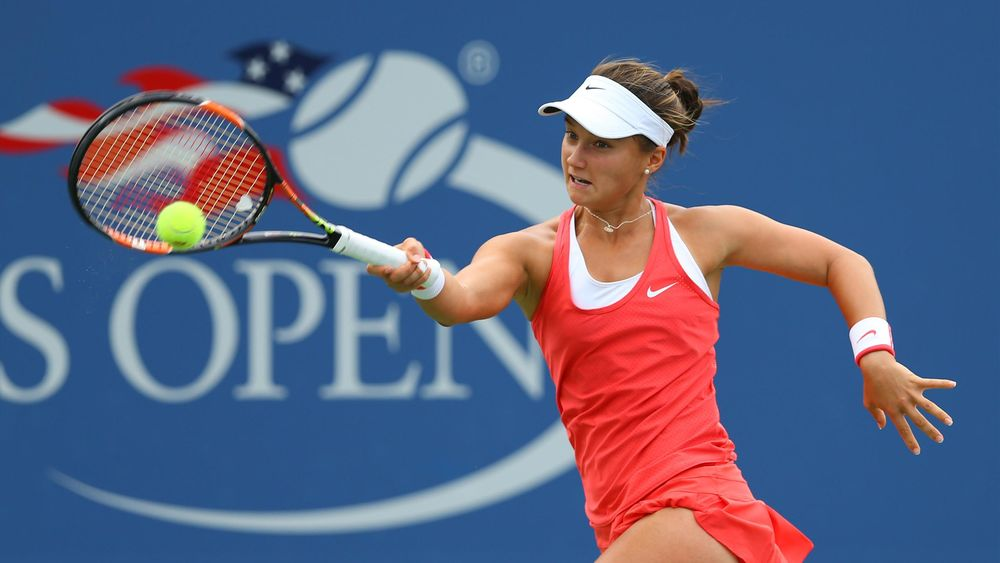 Lauren Davis of the United States returns a shot to Heather Watson of Great Britain on day one of the 2015 U.S. Open tennis tournament at USTA Billie Jean King National Tennis Center. Mandatory Credit: Jerry Lai-USA TODAY Sports