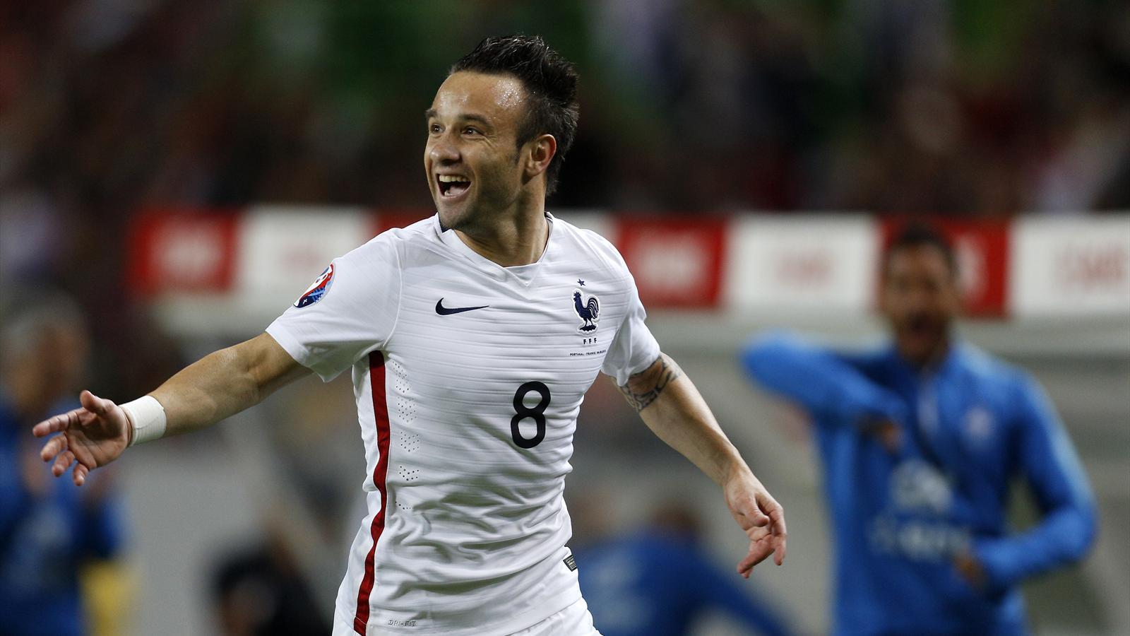 Mathieu Valbuena nets free kick but Nabil Fekir injured as France