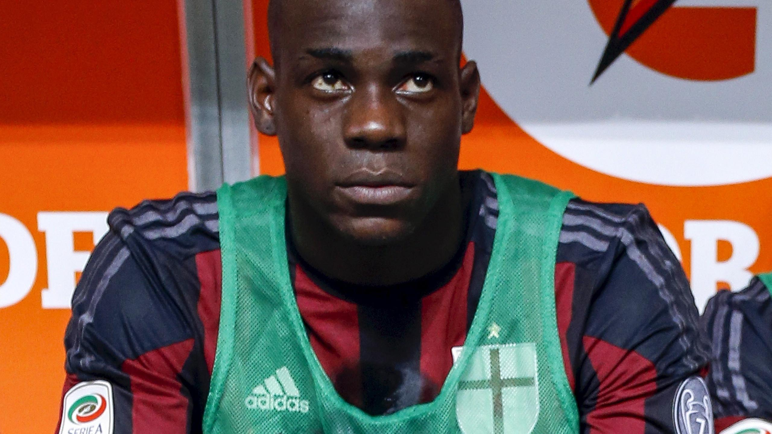 AC Milan's Mario Balotelli sits on the bench