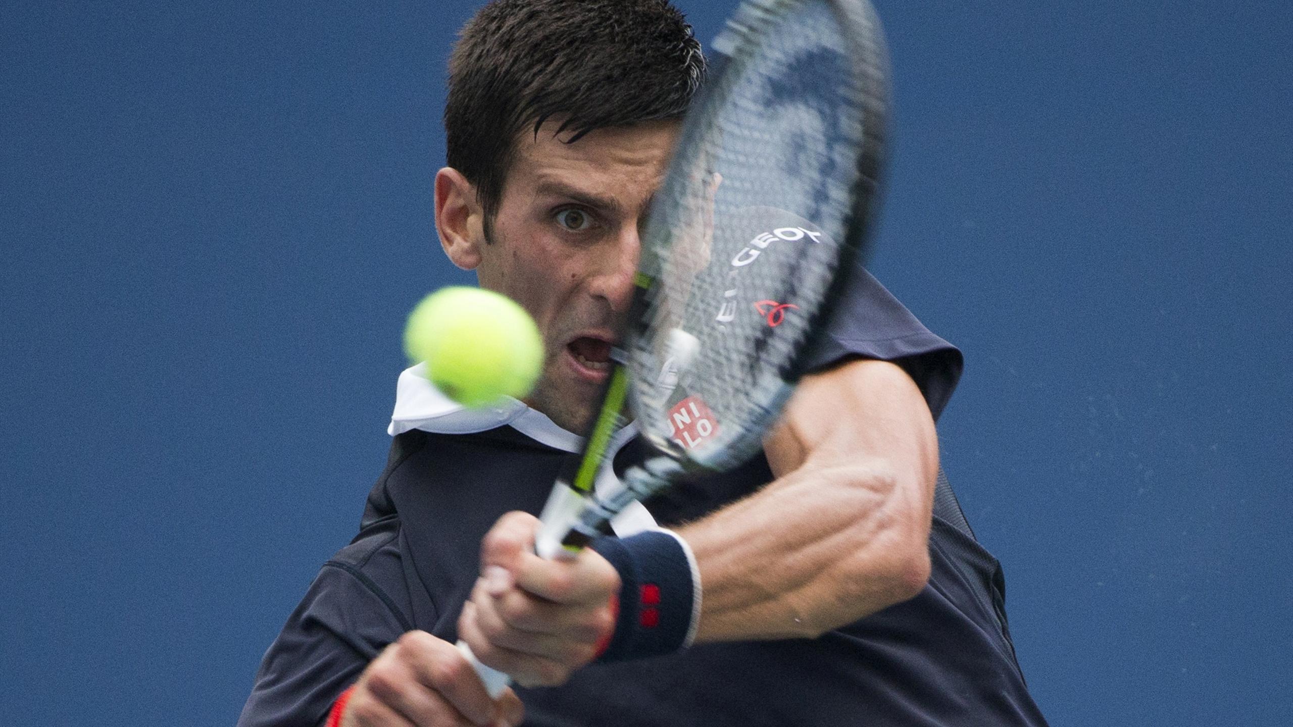 Novak Djokovic wrestles a backhand against Andreas Seppi