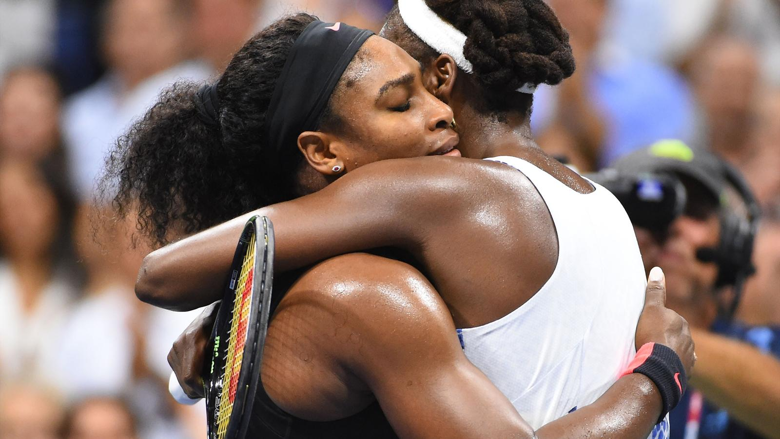 Serena Williams of the USA (left) hugs sister Venus Williams of the USA after their match on day nine of the 2015 U.S. Open tennis tournament at USTA Billie Jean King National Tennis Center