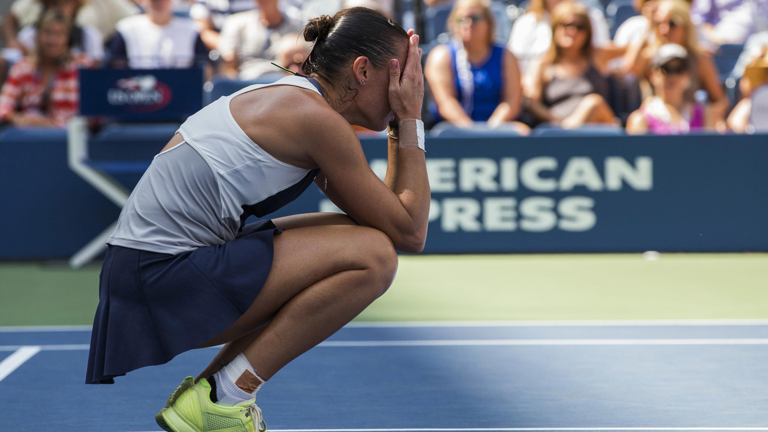 Flavia Pennetta reacts to a point against Petra Kvitova