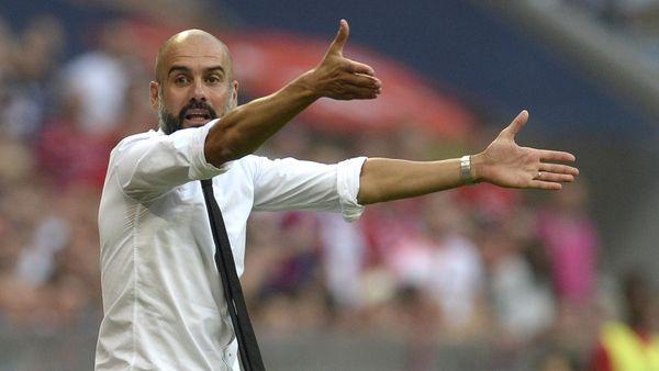 Bayern Munich's Spanish headcoach Pep Guardiola gestures during the German first division Bundesliga football match Bayern Munich vs Bayer 04 Leverkusen in