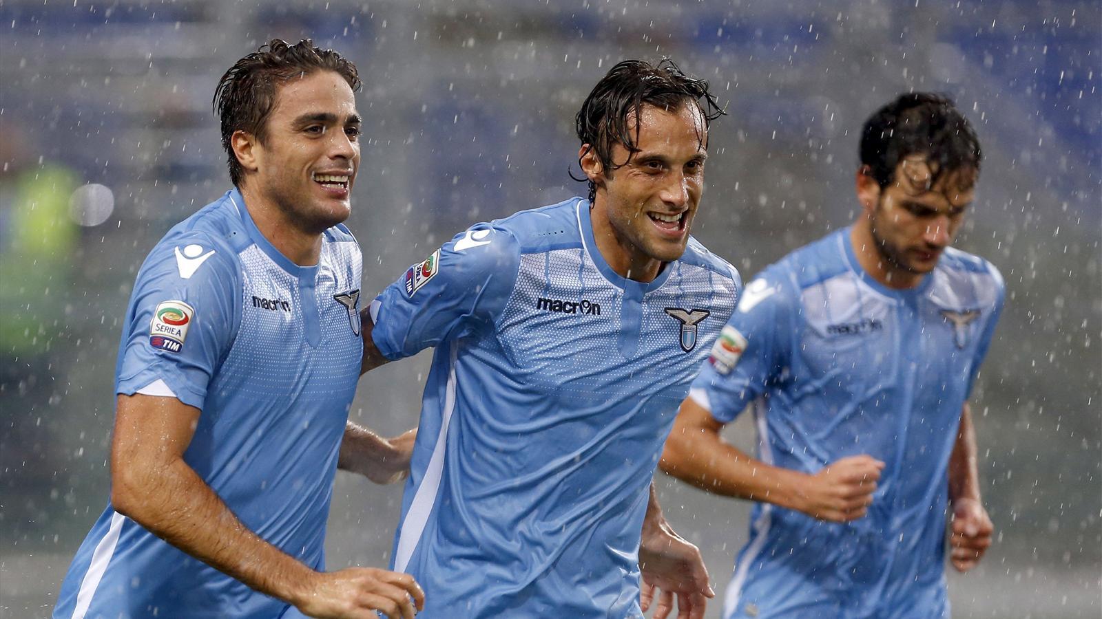 Alessandro Matri celebrates with Lazio teammates Stefano Mauri and Marco Parolo