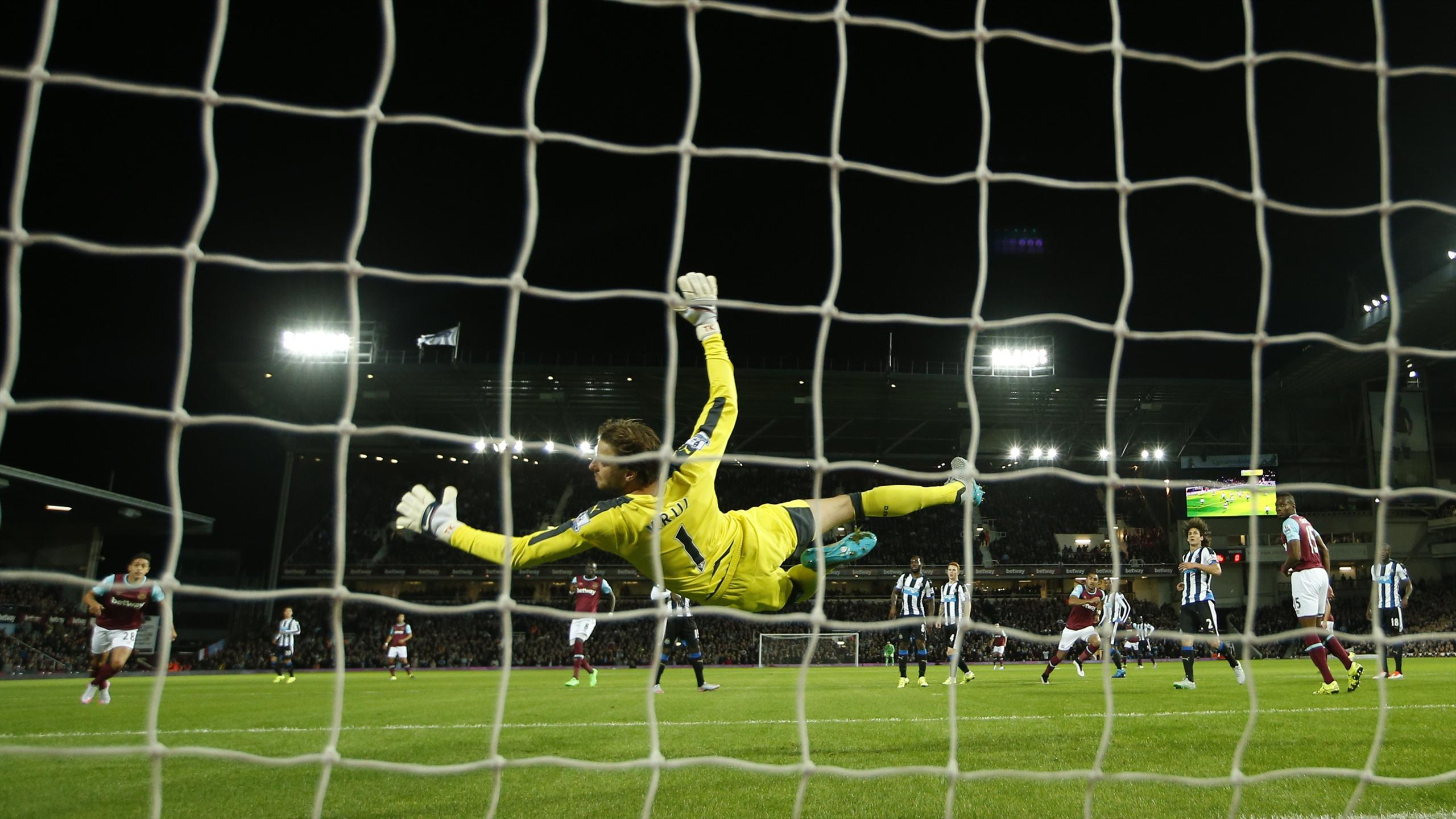 Newcastle's Tim Krul concedes West Ham United's first goal scored by Dimitri Payet