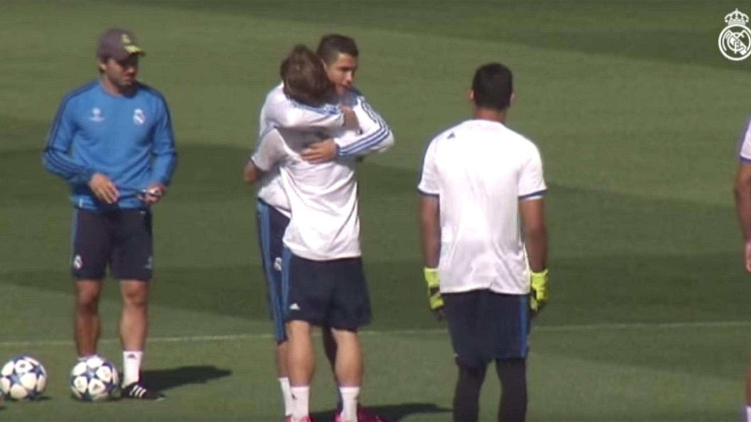 Cristiano Ronaldo hugged by Luka Modric during Real Madrid training.