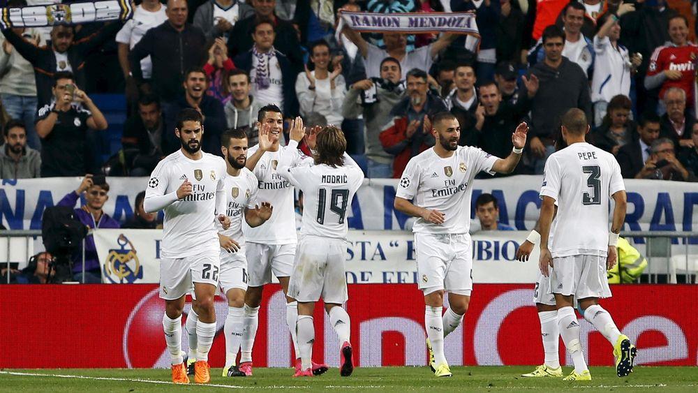 Real Madrid's Cristiano Ronaldo (3rd L) celebrates scoring against Shakhtar Donetsk
