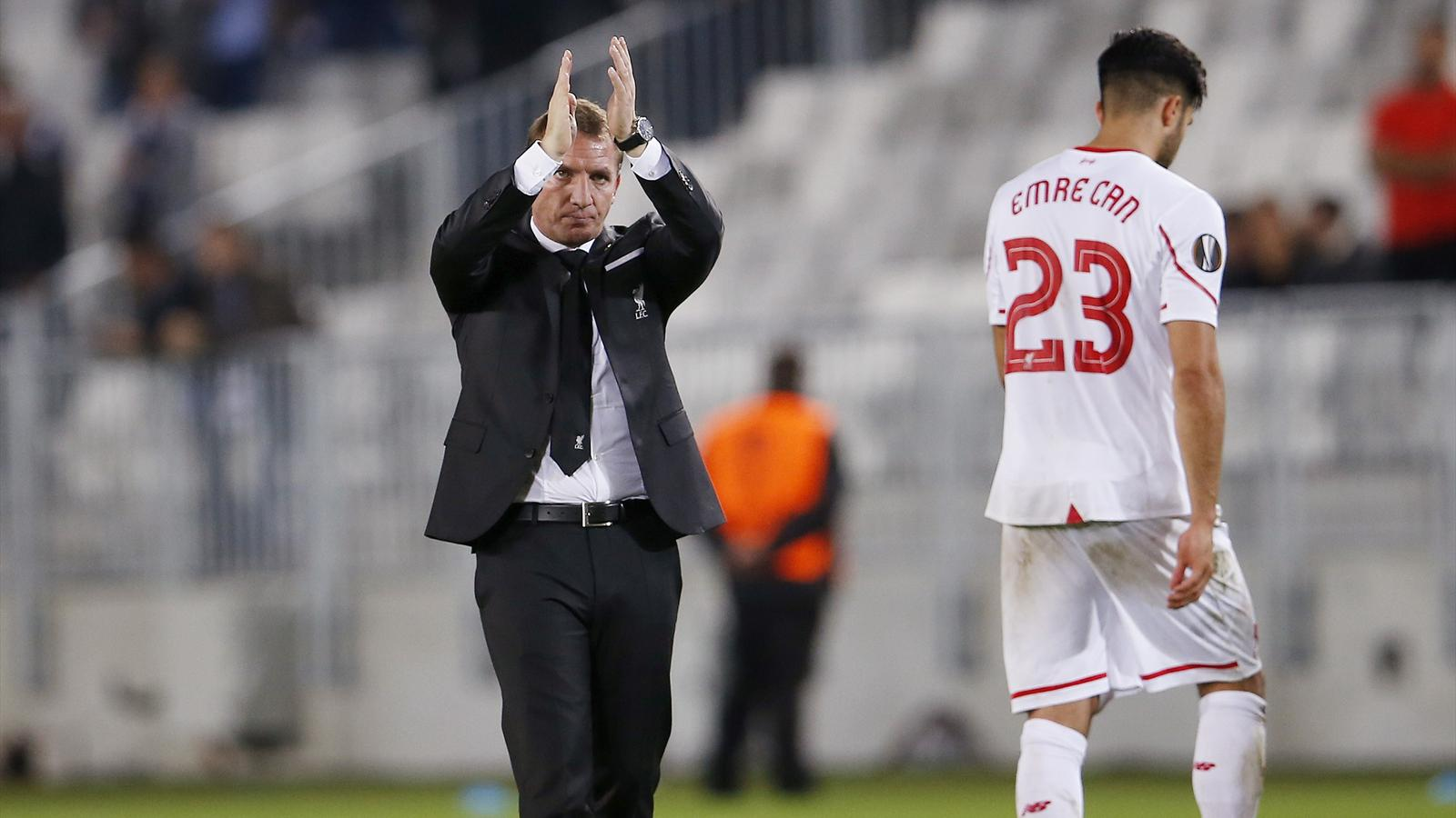 Liverpoool manager Brendan Rodgers applauds the fans at the end of the match with Bordeaux