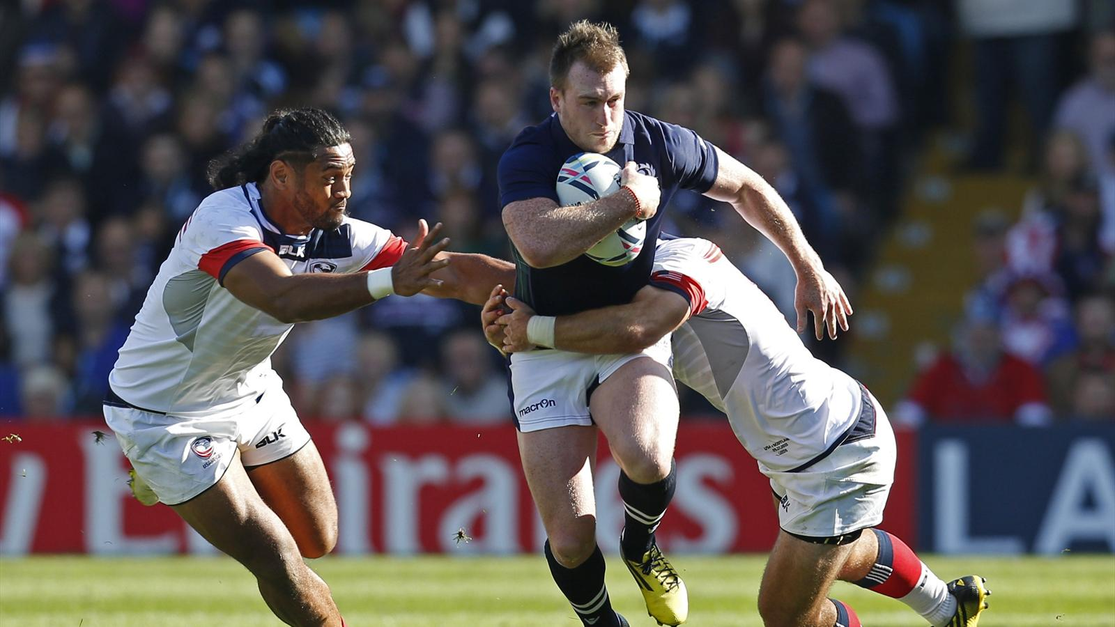 Scotland's Stuart Hogg in action with USA's Thretton Palamo and Seamus Kelly