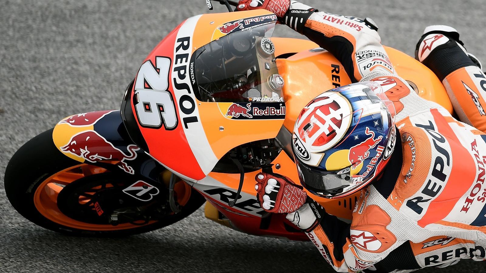 Repsol Honda Team's Spanish rider Dani Pedrosa powers his bike during the second practice session of the MotoGP Malaysian Grand Prix at Sepang International Circuit on October 23, 2015