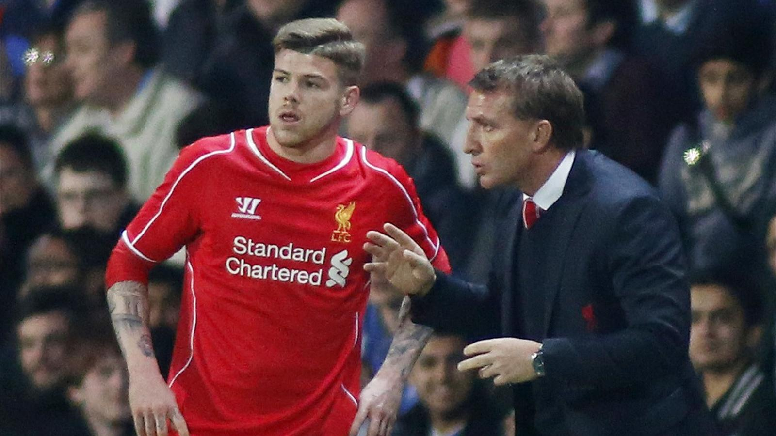 Liverpool's Alberto Moreno talks to manager Brendan Rodgers
