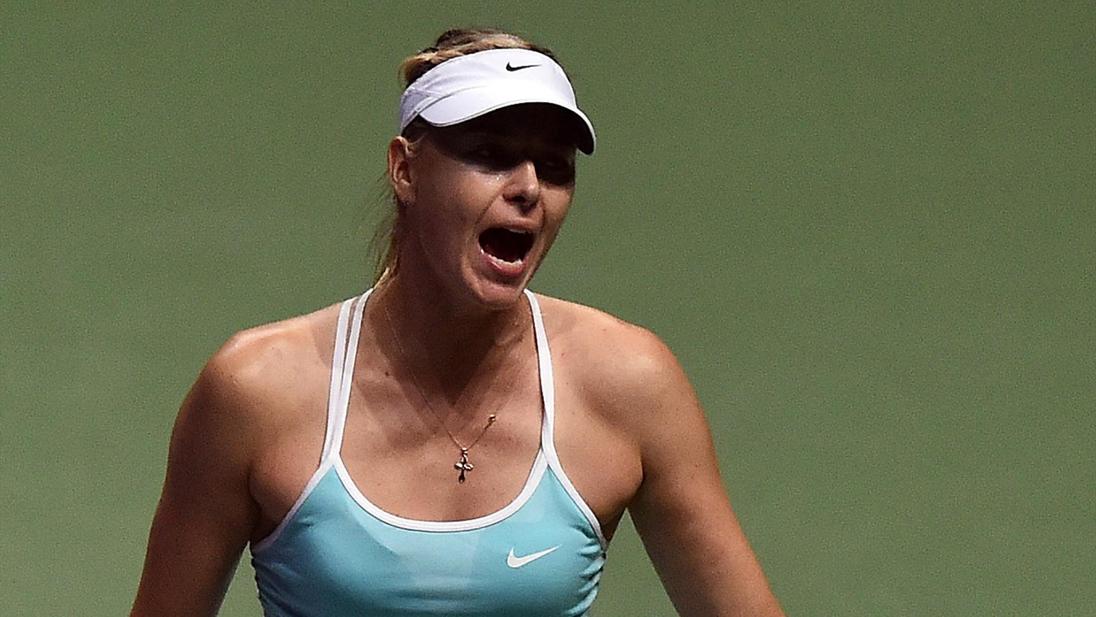 Maria Sharapova of Russia reacts to a point against Petra Kvitova of Czech Republic during their women's singles semi-final tennis match at the WTA Finals in Singapore on October 31, 2015