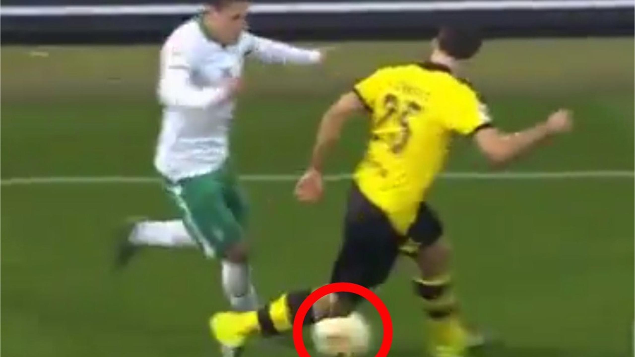 Borussia Dortmund's Sokratis Papastathopoulos gets nutmegged by Werder Bremen's Zlatko Junuzovic