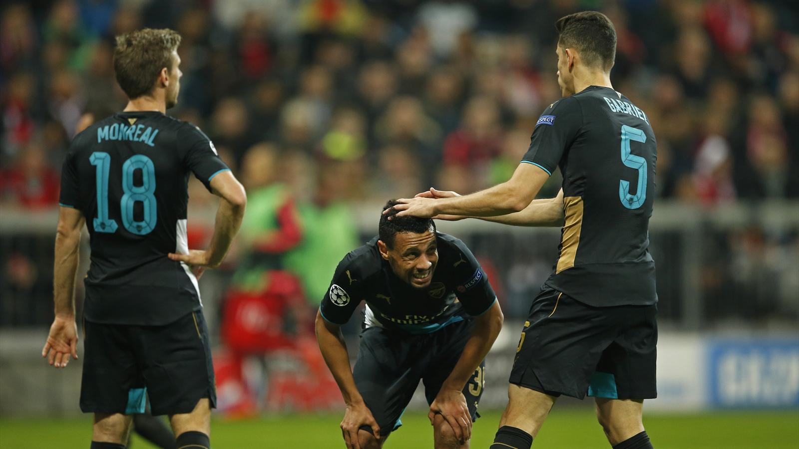 Arsenal's Francis Coquelin with Gabriel Paulista