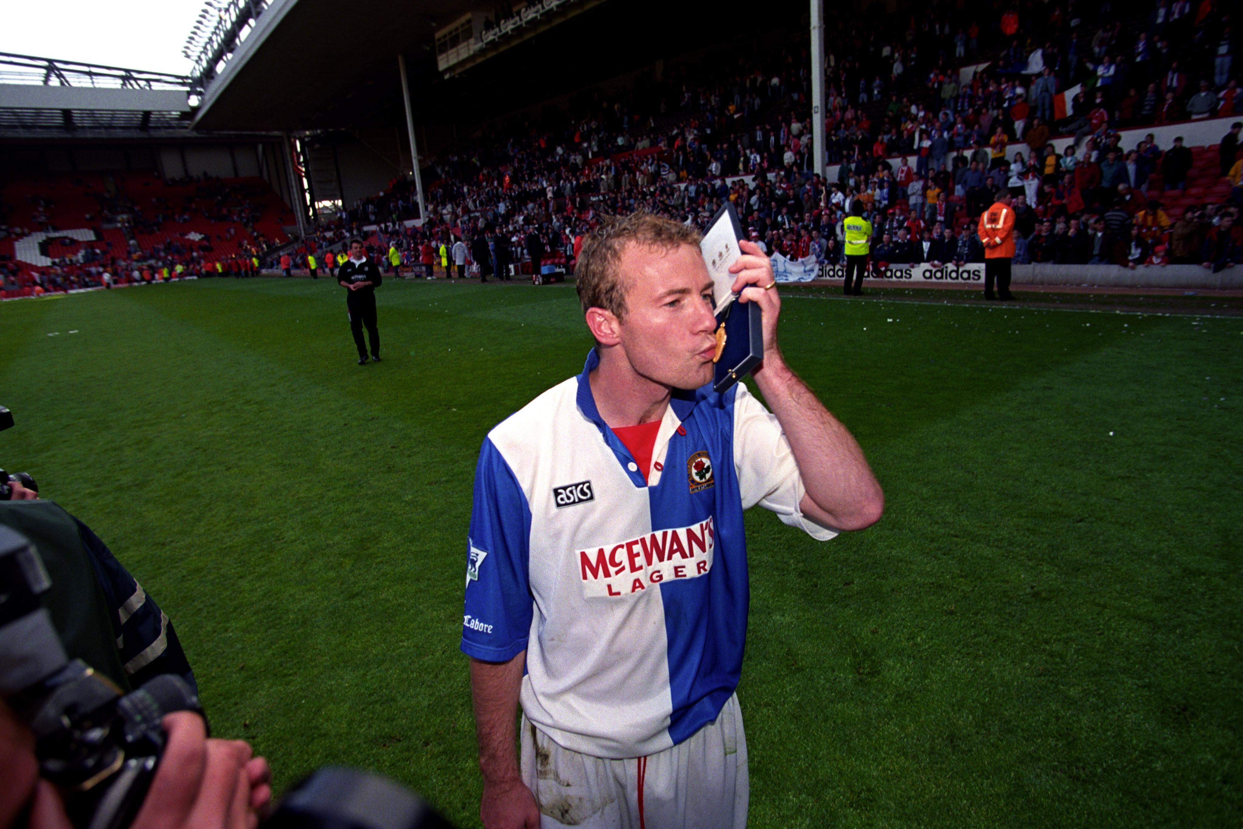 Blackburn Rovers striker Alan Shearer kisses his Premiership winners medal