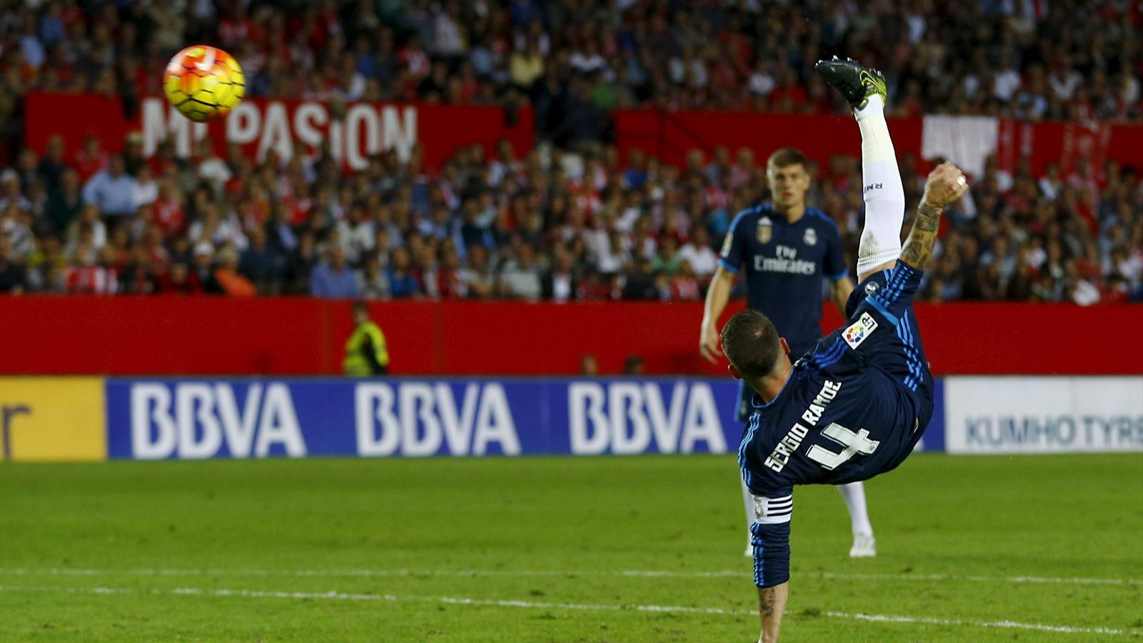 Real Madrid's Sergio Ramos kicks the ball to score against Sevilla