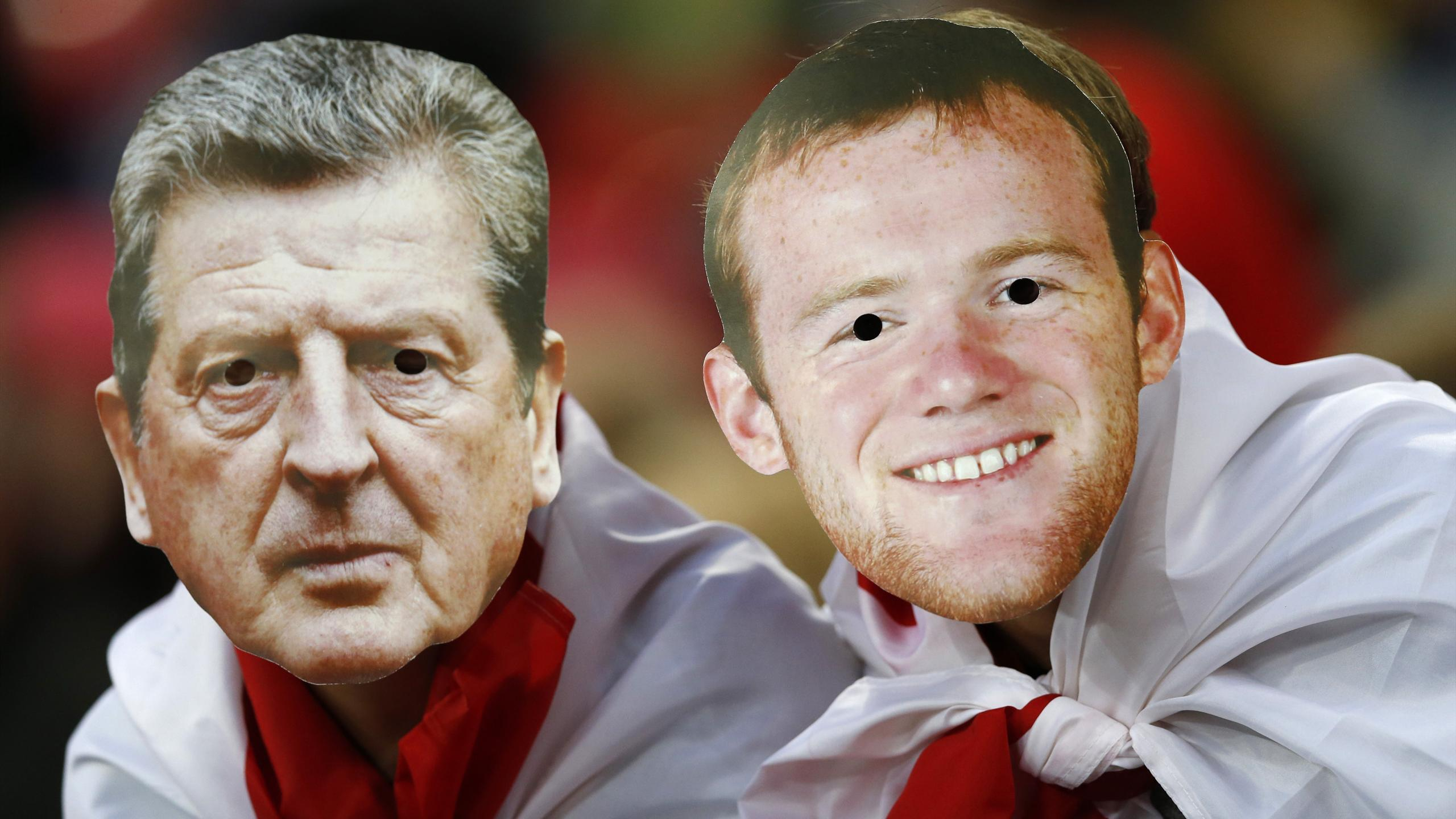Fans wearing Roy Hodgson and Wayne Rooney masks at an England game