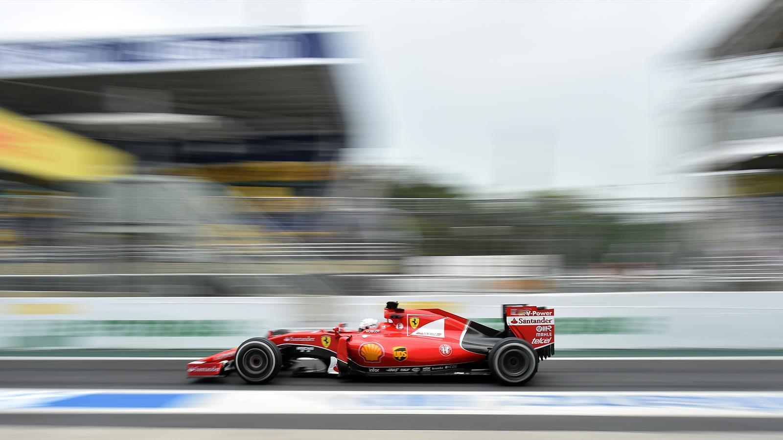 Ferrari's German driver Sebastian Vettel power his car at the Interlagos racetrack on November 13, 2015 in Sao Paulo, Brazil, ahead of the Brazilian Formula One GP next November 15th