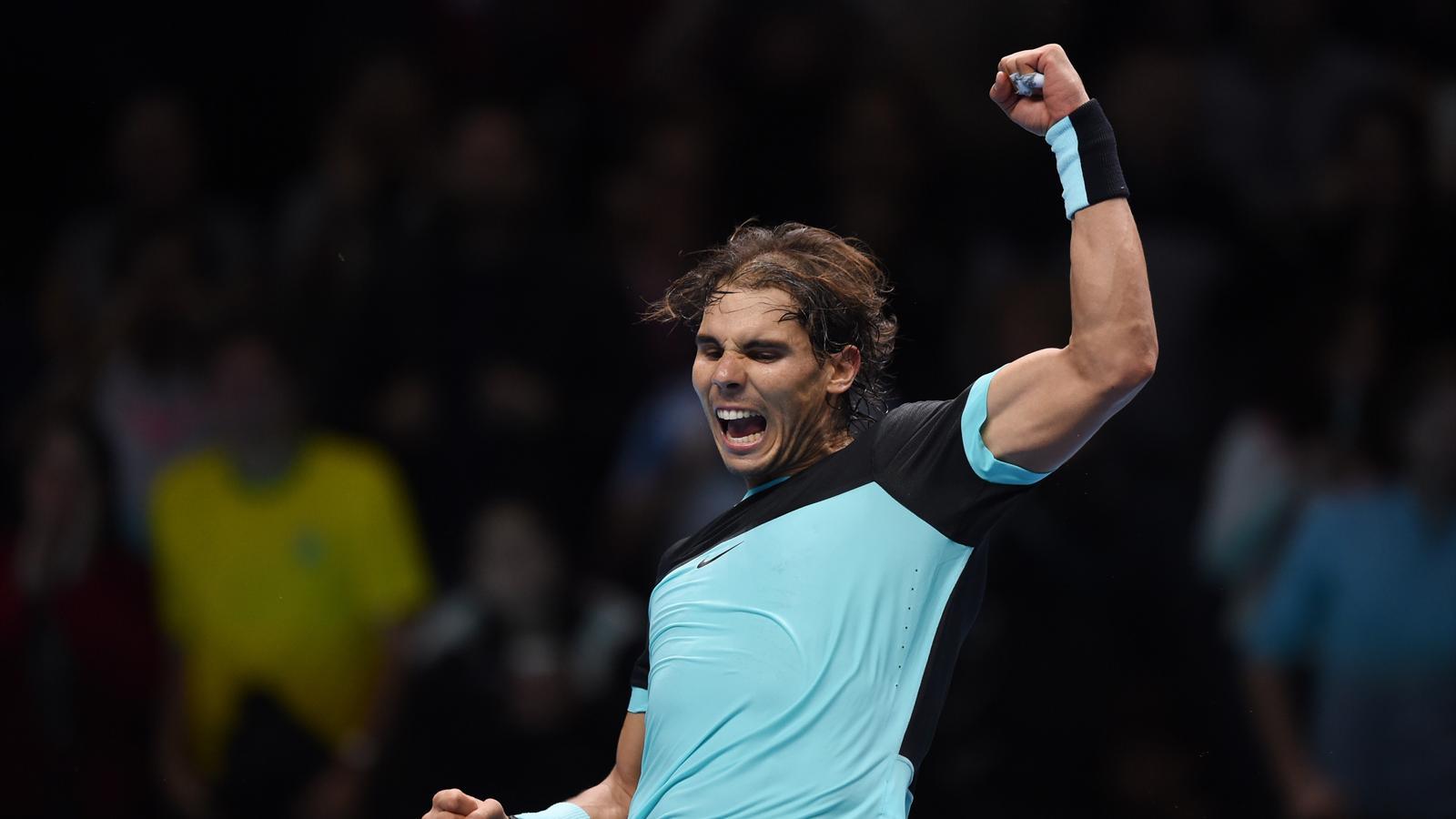Rafa Nadal celebrates winning the match