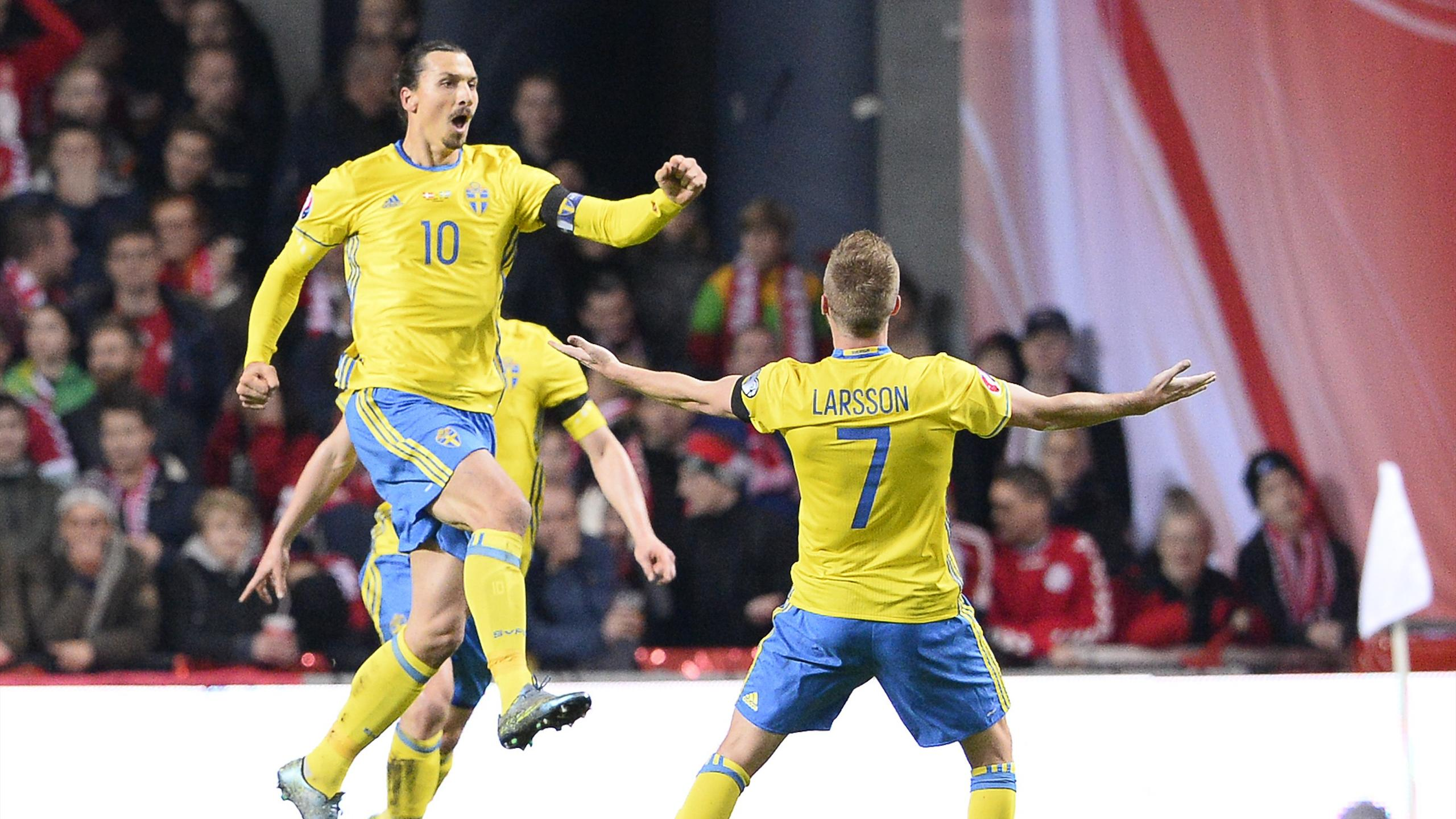 Sweden's forward and captain Zlatan Ibrahimovic (L) celebrates after scoring a goal during the Euro 2016 second leg play-off football match against Denmark at Parken stadium in Copenhagen