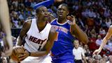Miami Heat clamp down on defense to destroy New York Knicks as LeBron James ties Oscar Robertson