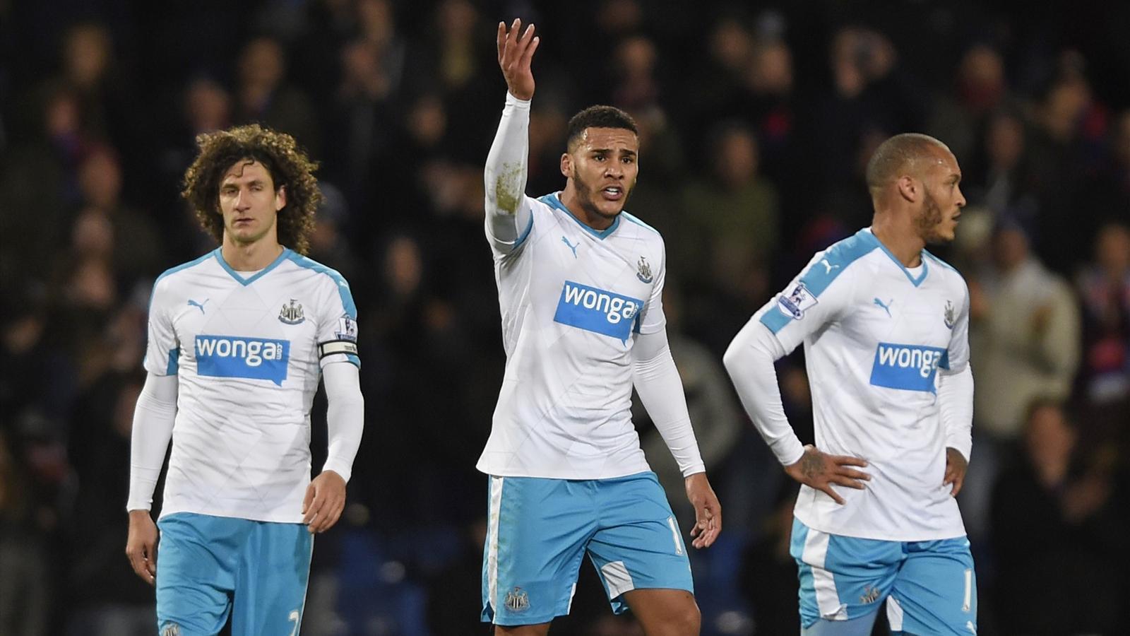 Fabricio Coloccini and his Newcastle team-mates look dejected